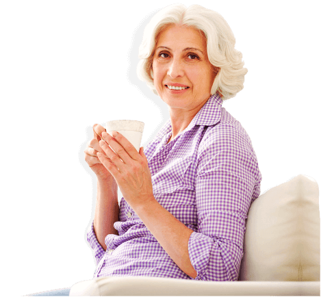 Cheerful mature lady is relaxing with hot tea in the morning